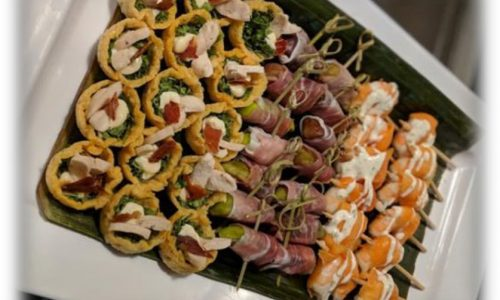 Skewers with meat balls pickles and ham and salmon